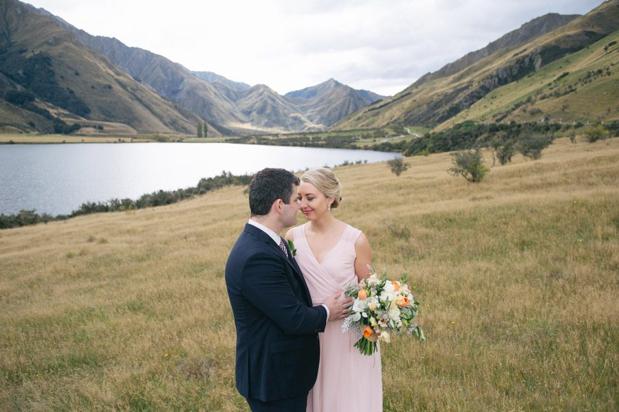 Lona and Greg at Moke Lake, Queenstown on their wedding day. Photographed by Queenstown wedding photographers, Alpine Image Company.