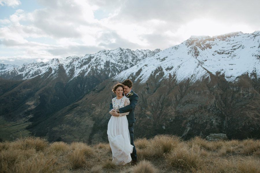 Sam and Tash on their beautiful Queenstown wedding day up in the mountains after their wedding ceremony captured by Queenstown wedding photographer Alpine Image Company. Such a stunnning mountain wedding!