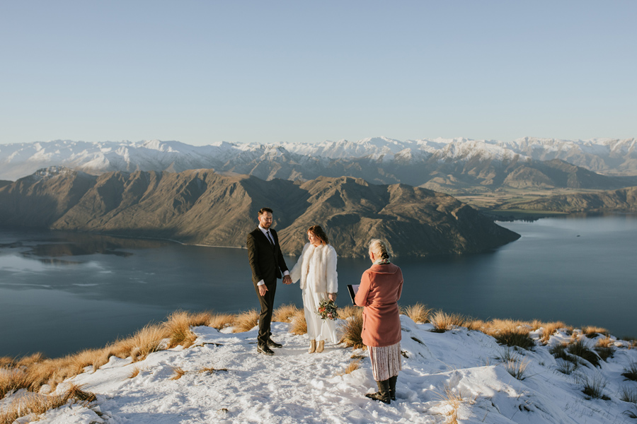 Donna and Michael face each other during their ceremony on top of Coromandel Peak. With photography by Alpine Image Company