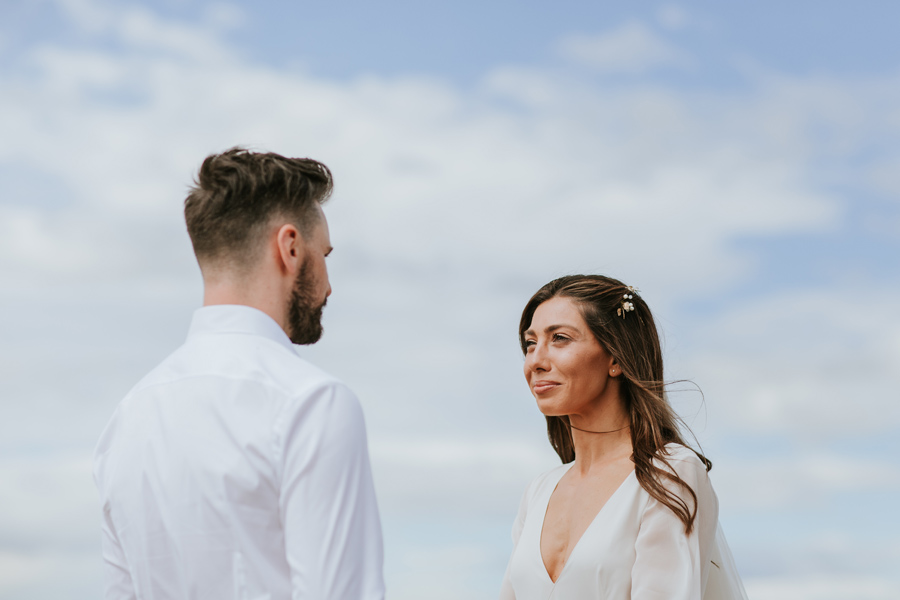 The gorgeous bride Briana looks at her husband as they say their vows to each other during their Wanaka Wedding Ceremony.